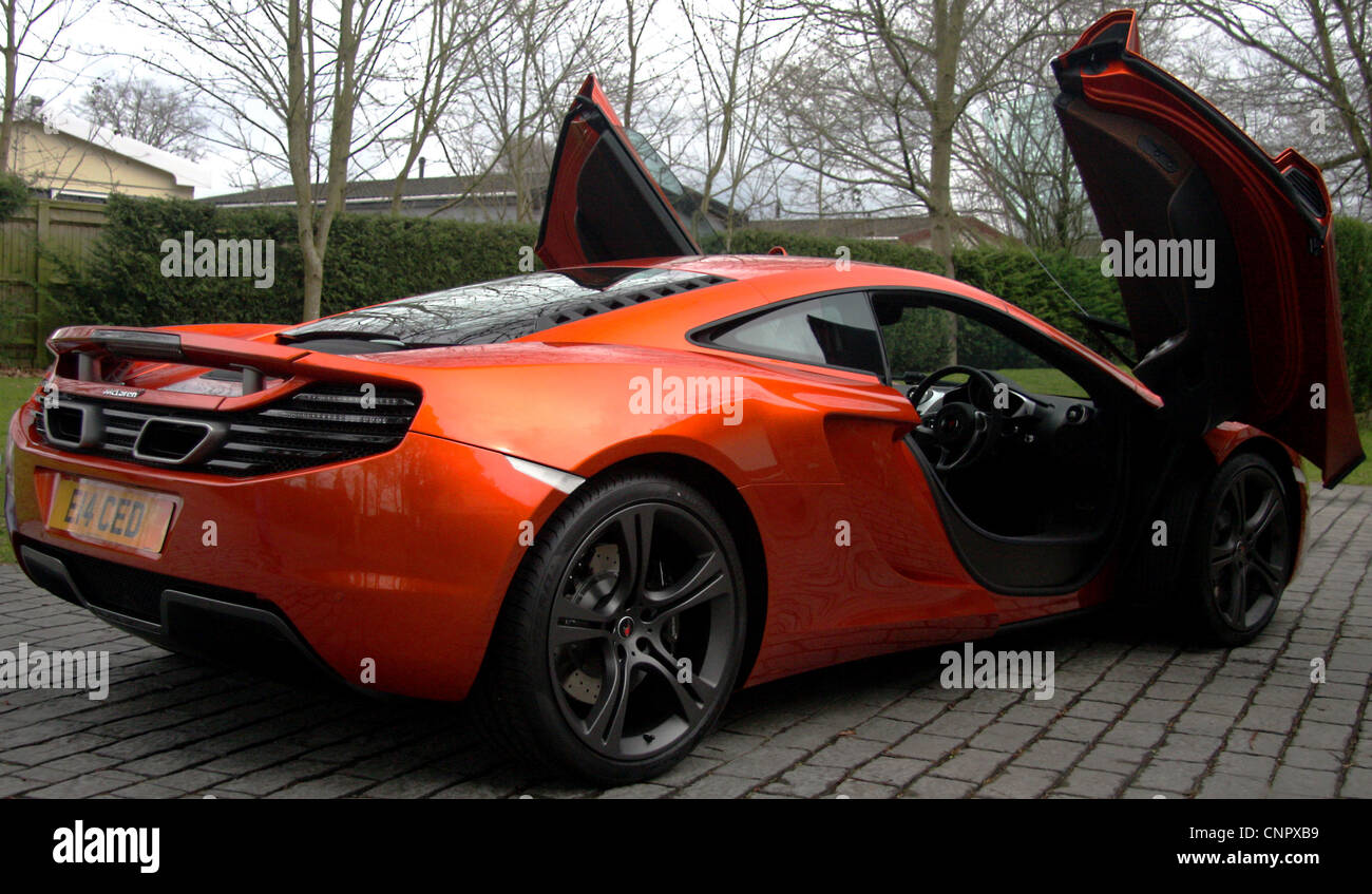 A new McLaren MP4-12C on a driveway with the doors open & A new McLaren MP4-12C on a driveway with the doors open Stock ...