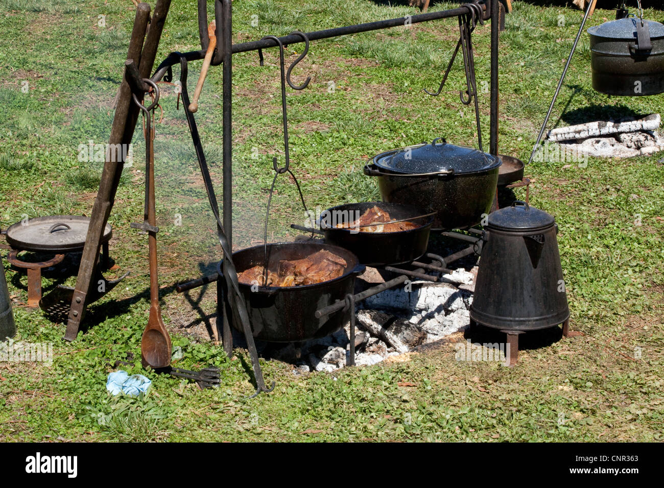 Cooking over a camp fire with cast iron pots and coffee for Pot de chambre camping