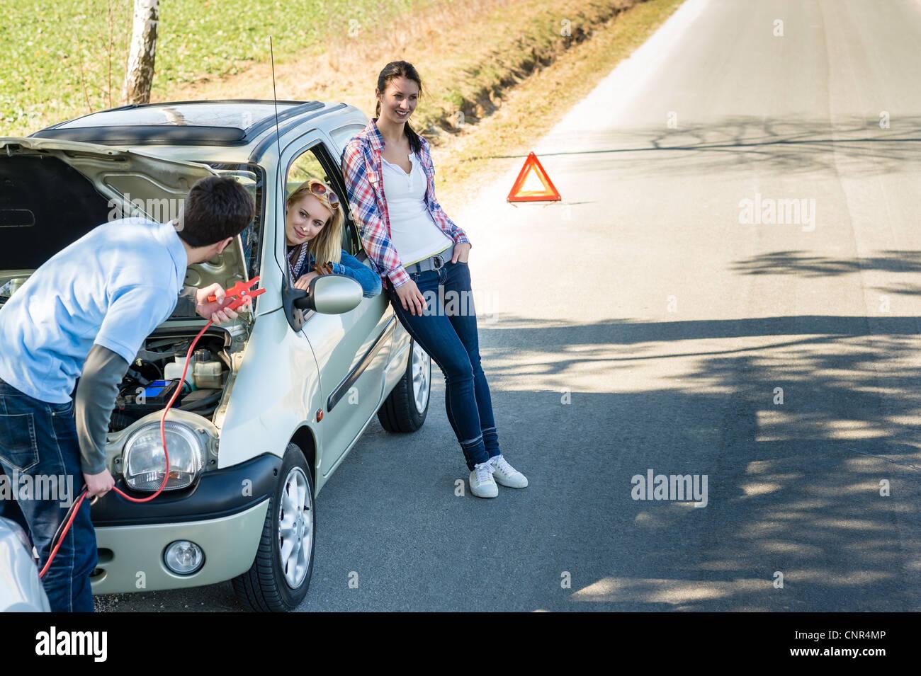 Car failure man help two female friends repair engine Stock Photo ...