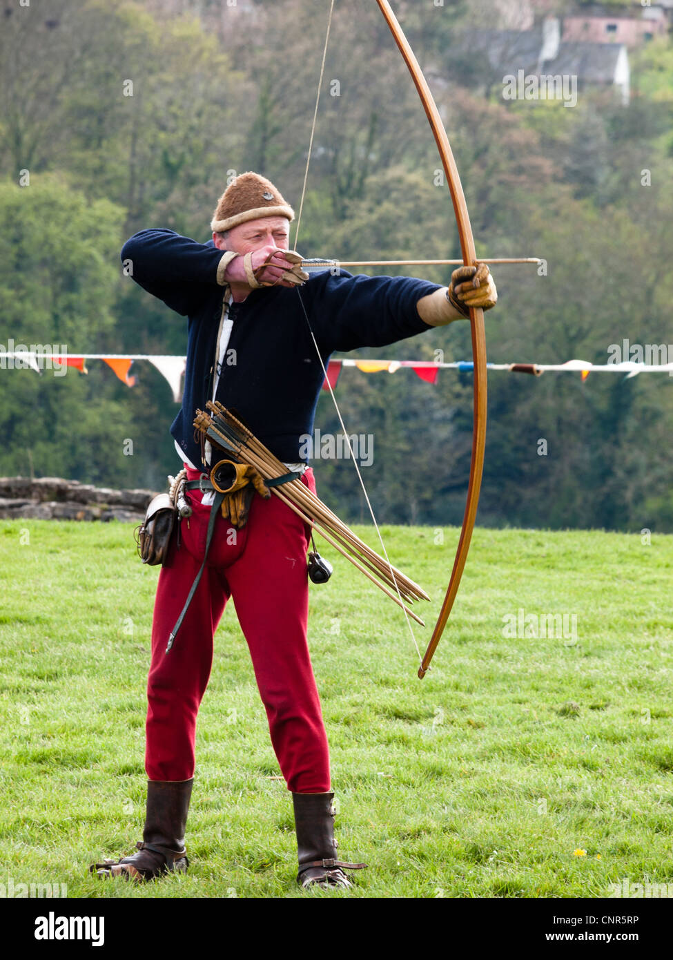 At a medieval reenactment an archer demonstrates the english longbow stock photo