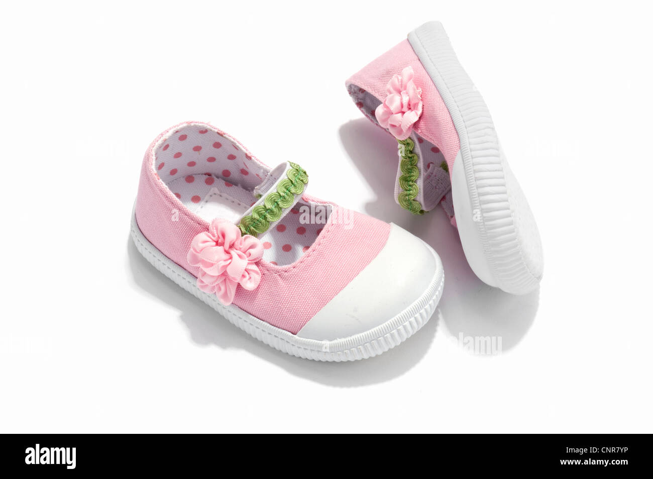 a pair of pink baby shoes stock photo royalty free image