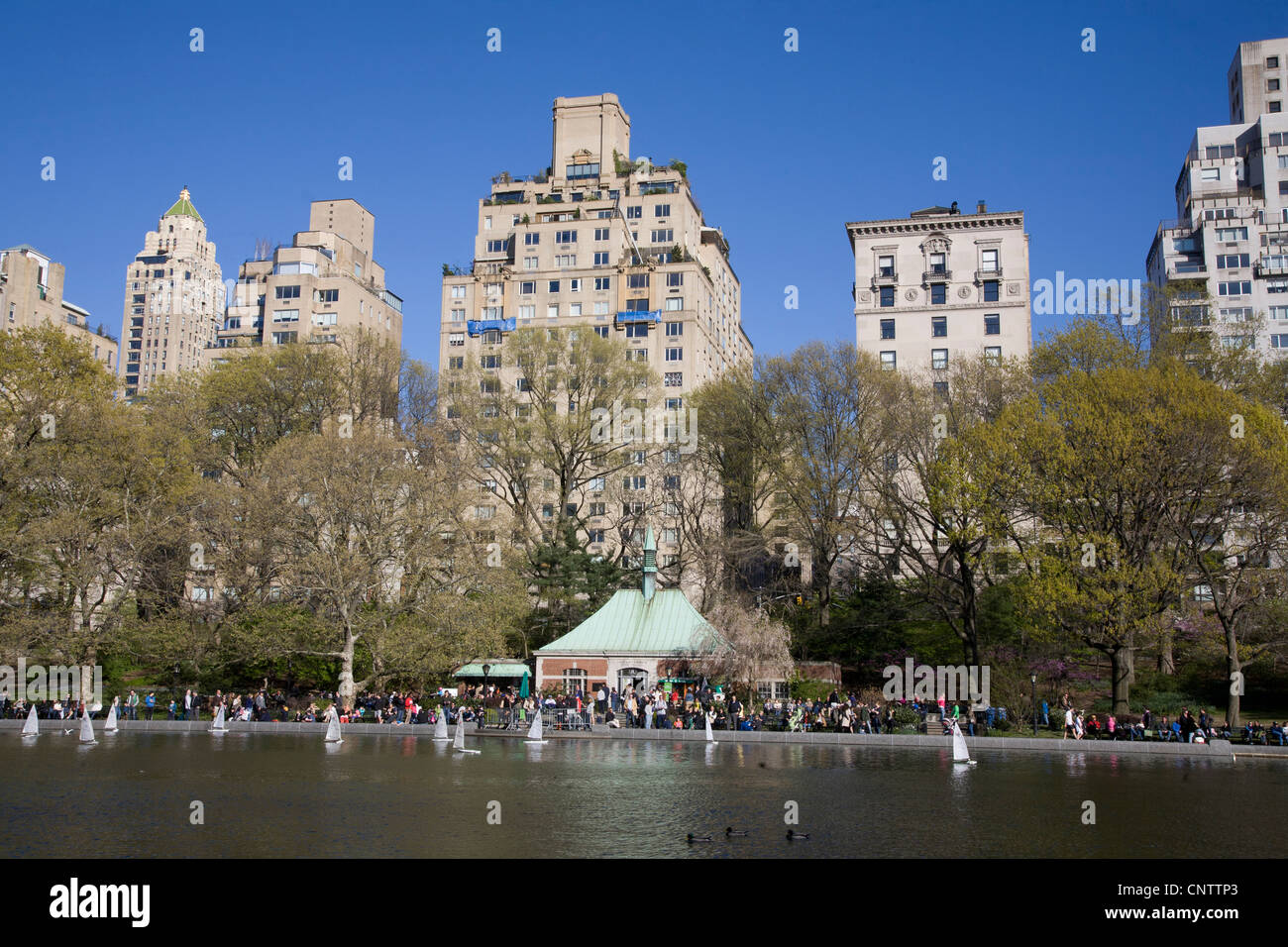 Toy Boat Pond At Nd Street In Central Park With Buildings Along - Central park on east 72nd street