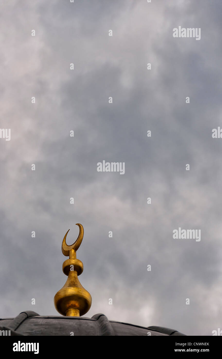 An islamic crescent moon symbol on top of a mosque dome set an islamic crescent moon symbol on top of a mosque dome set against a backdrop of a moody sky biocorpaavc Gallery