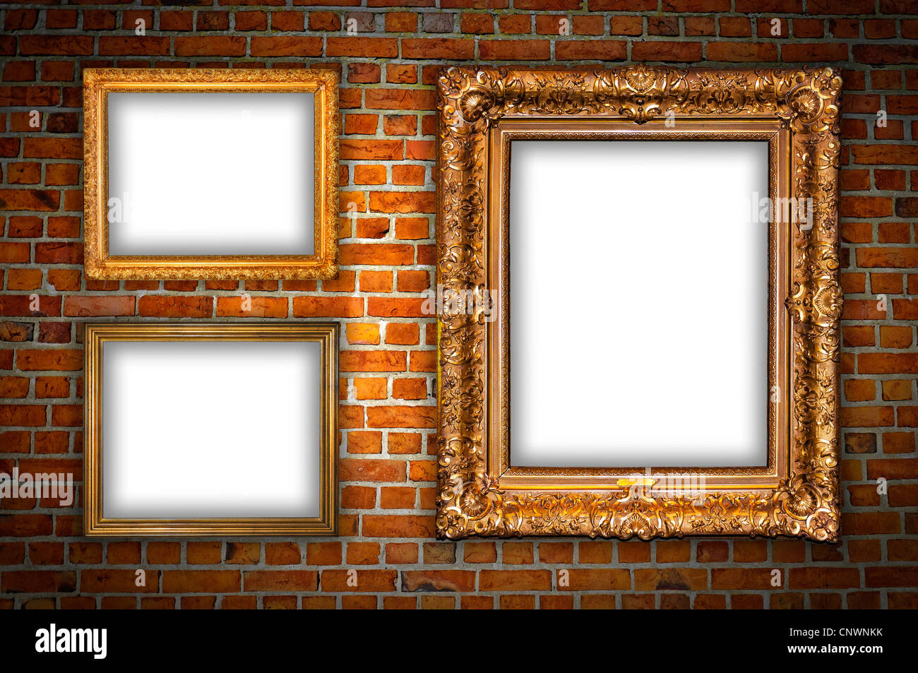 Old ornate golden frames hanging on a brick wall stock for Hanging frames on walls