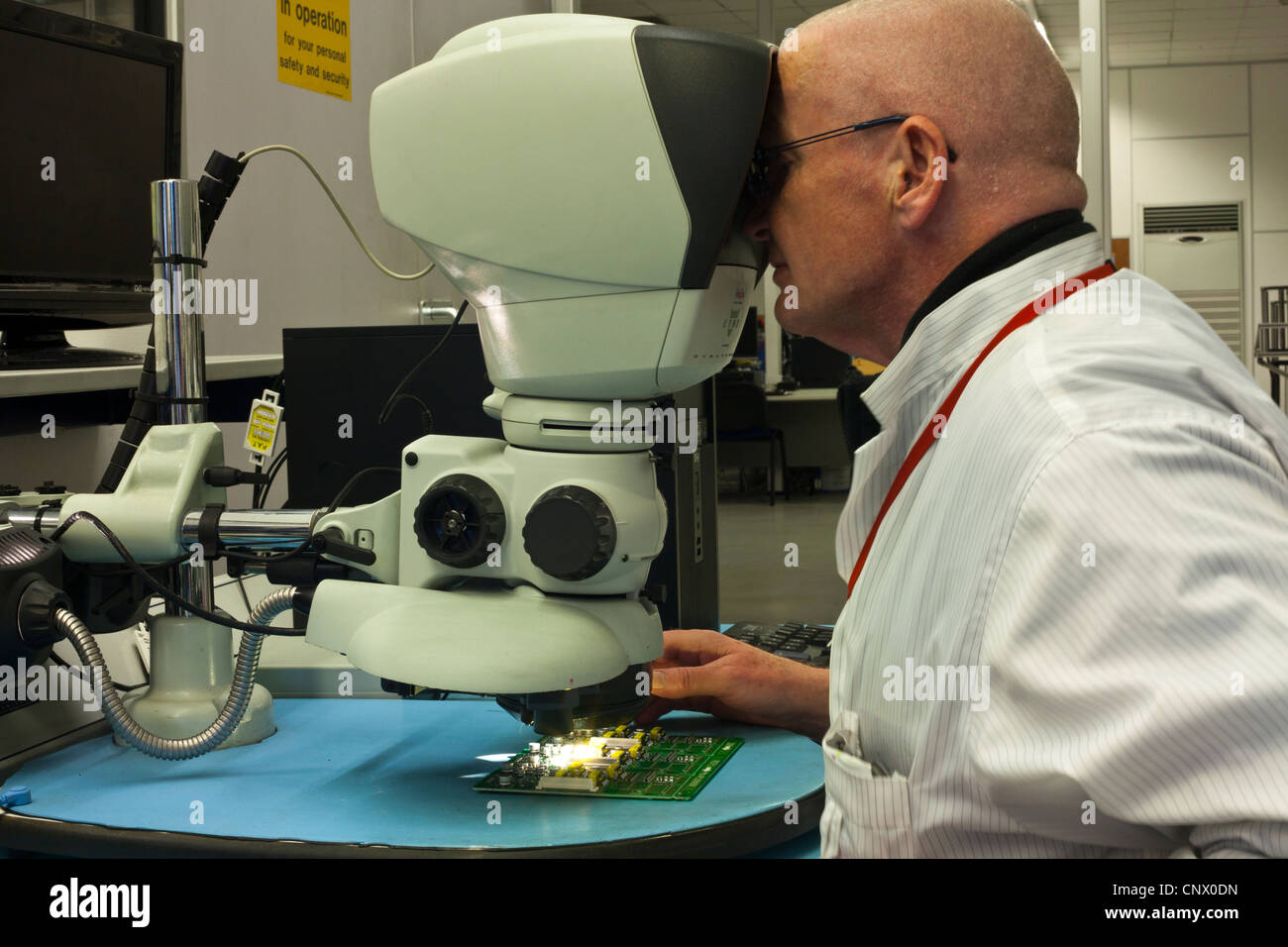 Engineer carrying out quality inspection of PCB assembled in SMT ...