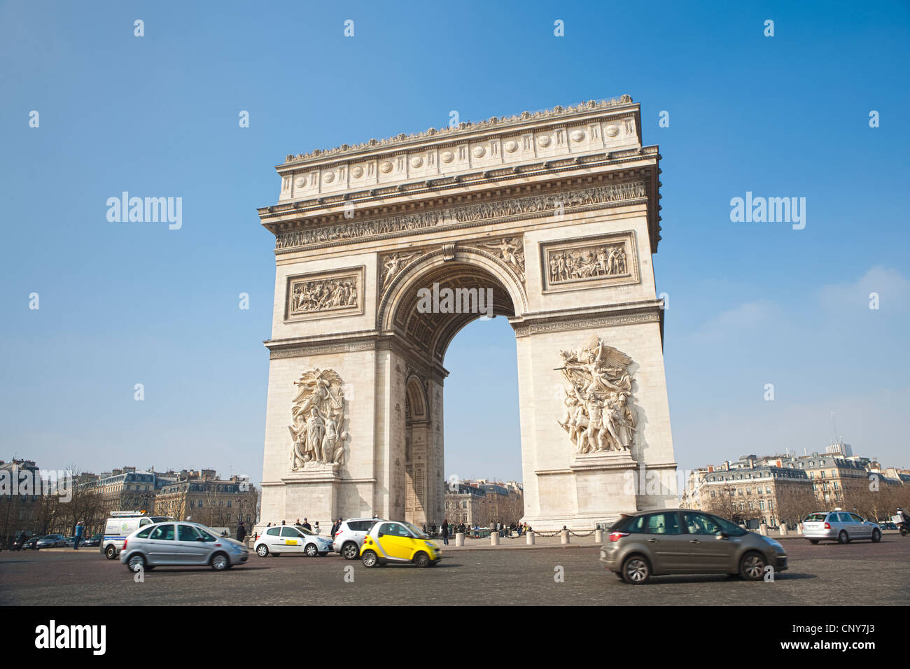 yellow smart car in traffic circle around arc de triomphe paris stock photo royalty free image. Black Bedroom Furniture Sets. Home Design Ideas