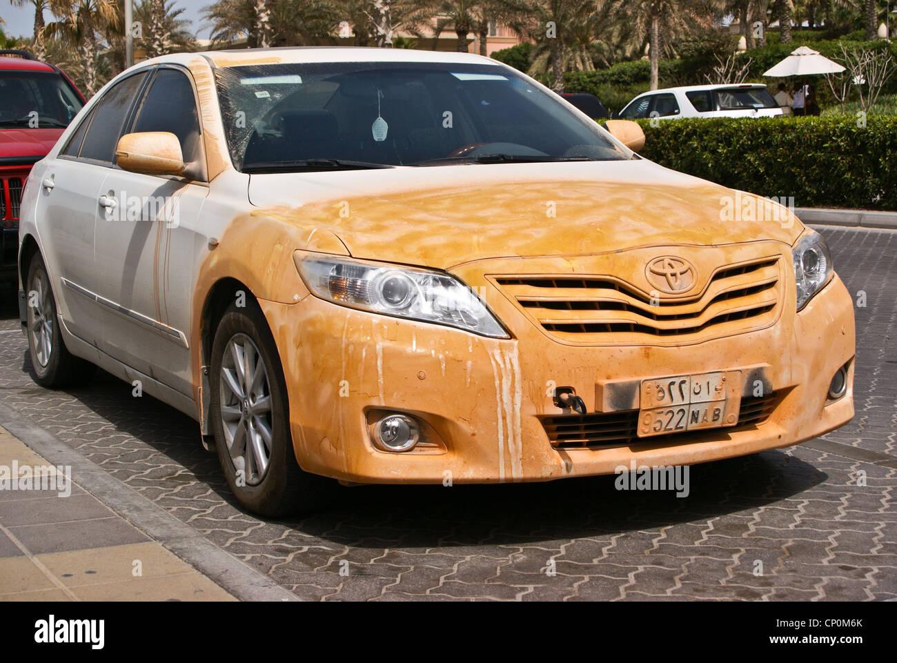 A white toyota camry with orange paint pattern dubai united arab emirates stock