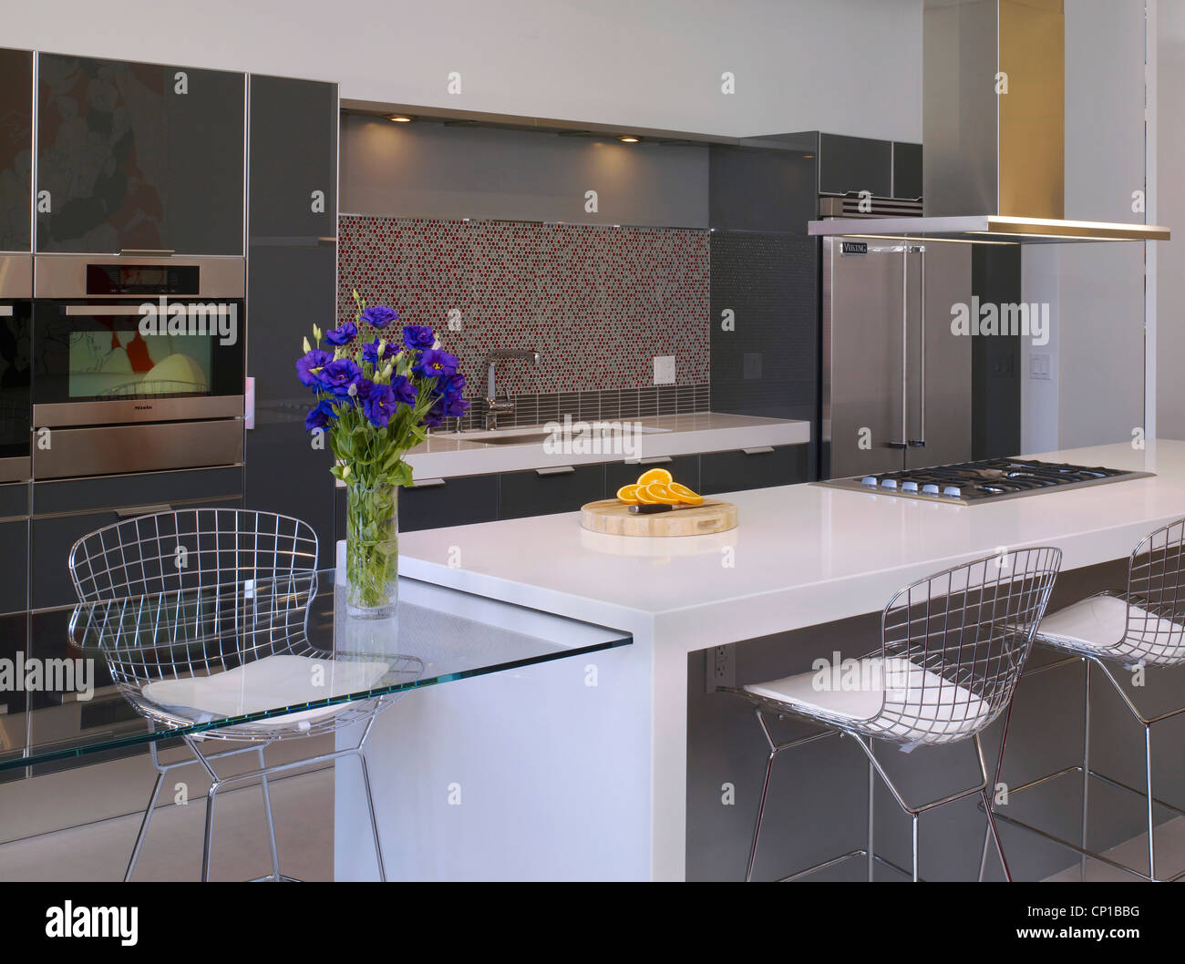 Stock Photo   Wire Mesh Chairs And Stainless Steel Appliances In Kitchen Of  Broadway Loft Apartment, Hollywood, US