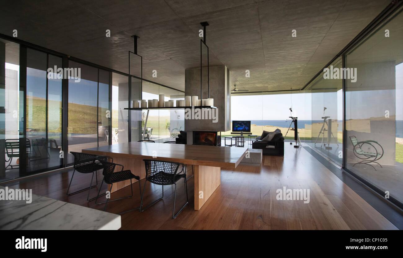 Open plan dining area with internal chimney, Flinders House, John ...
