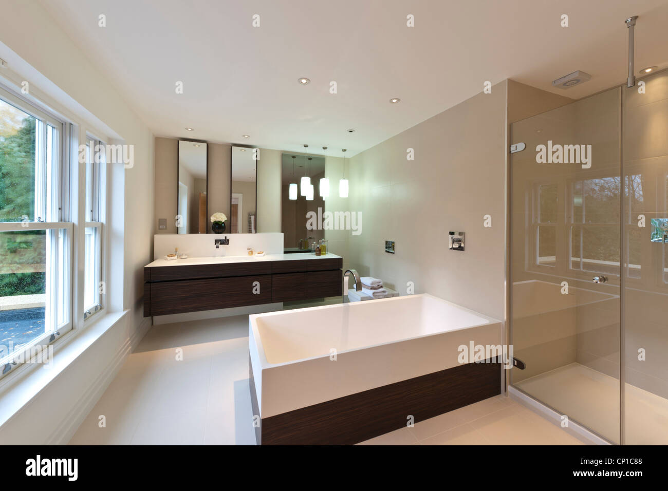 Stock Photo   View Of Modern Bath, Double Width Wash Basi And Glass Shower  Enclosure In A New Build House In Virginia Water, Surrey