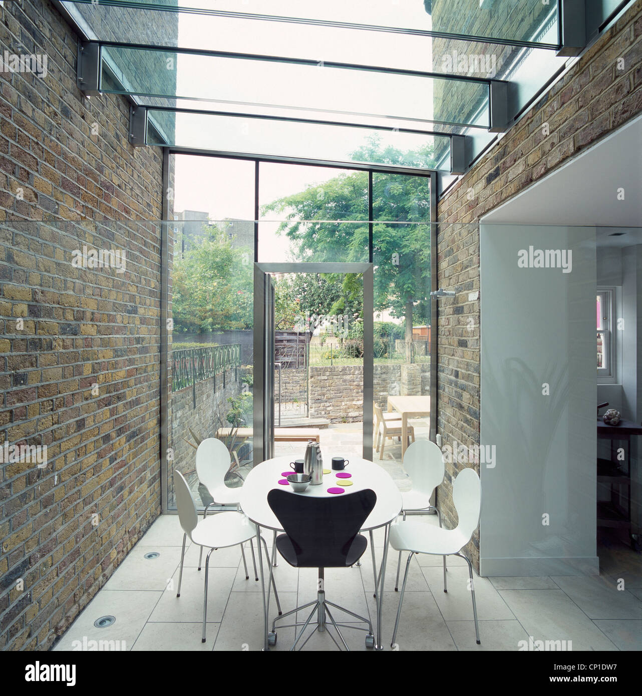 A Modern Dining Room In Glass Conservatory Extension Circular Table And Chairs