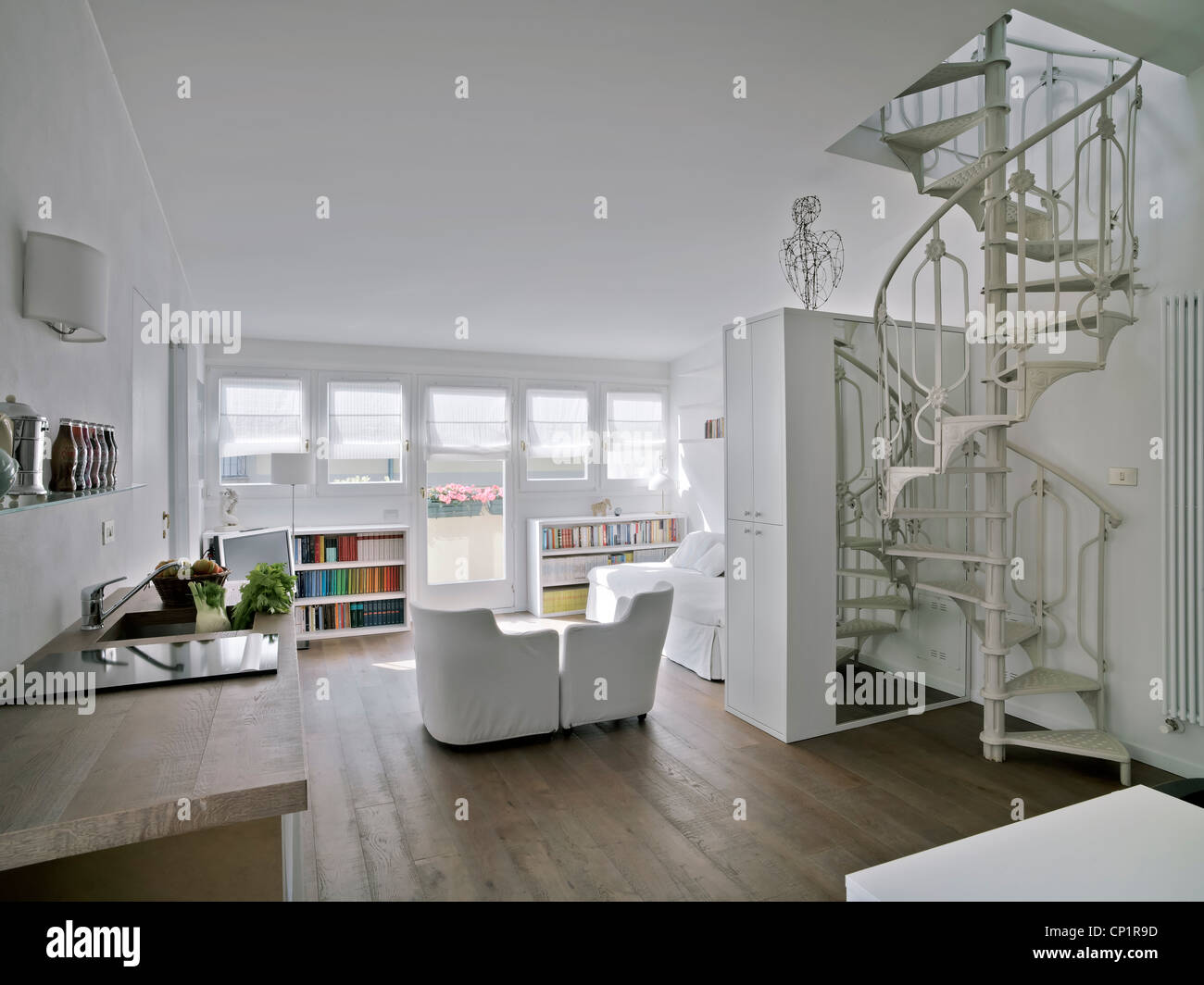 Modern Living Room With A Spiral Staircase And Wood Floor Stock Photo Royalty Free Image