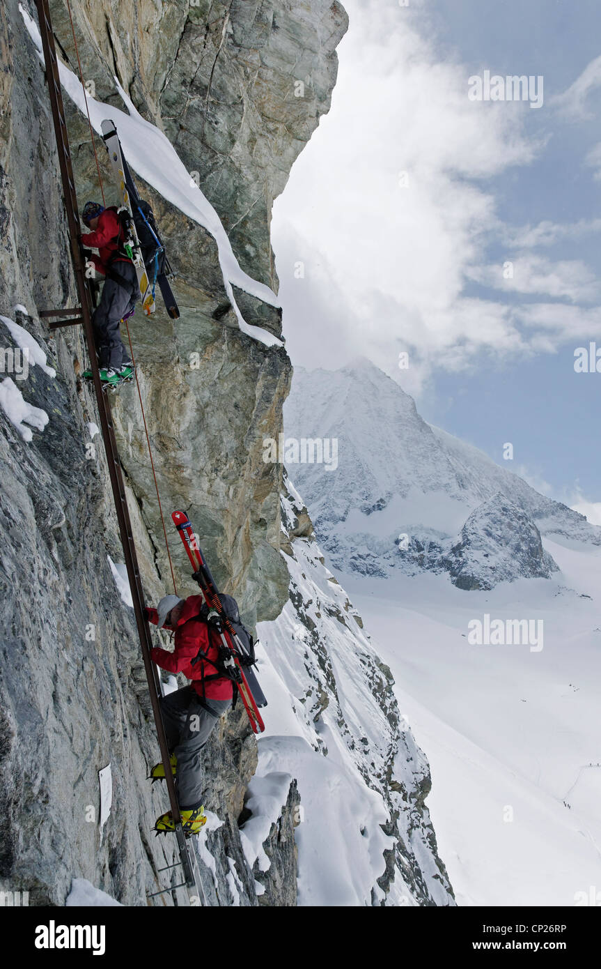 Ski Tourers Descending The Ladders At The Pas De Chevres Switzerland  The Ladders