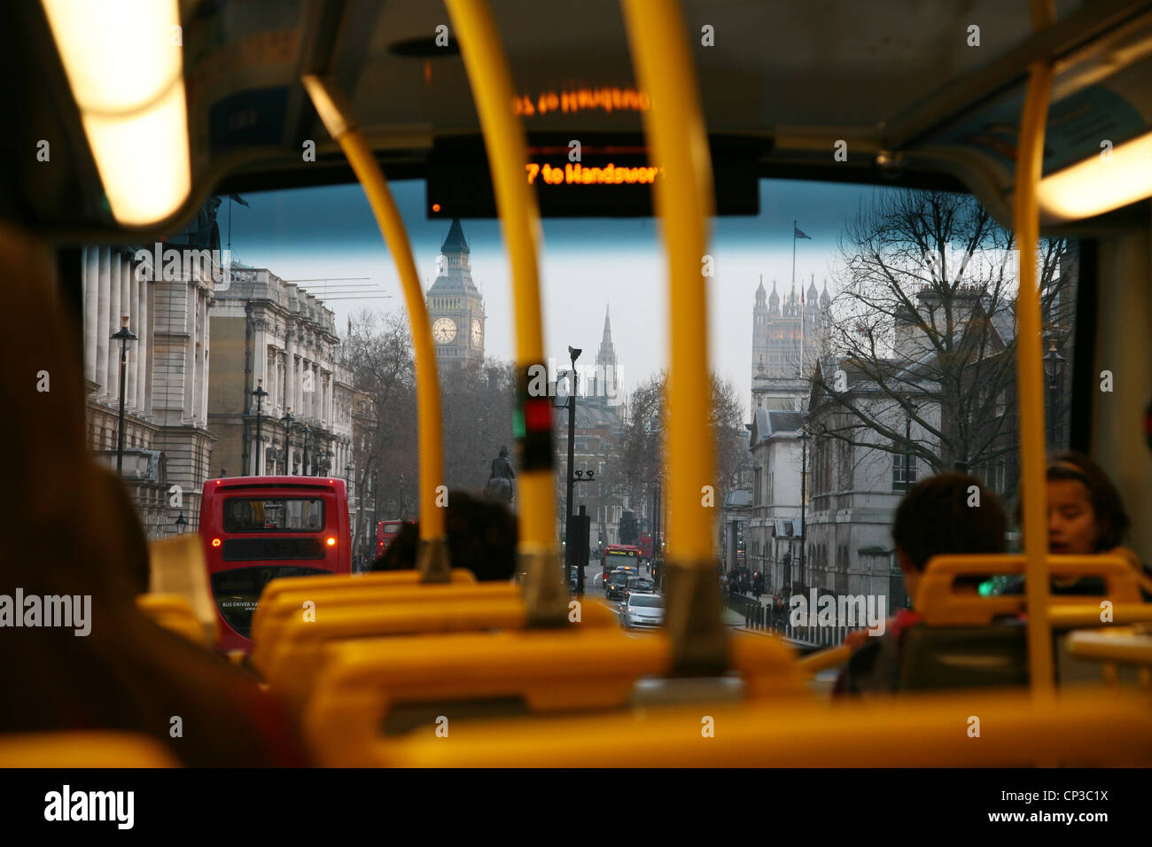 Inside view of London Double Decker Bus, passengers are ...