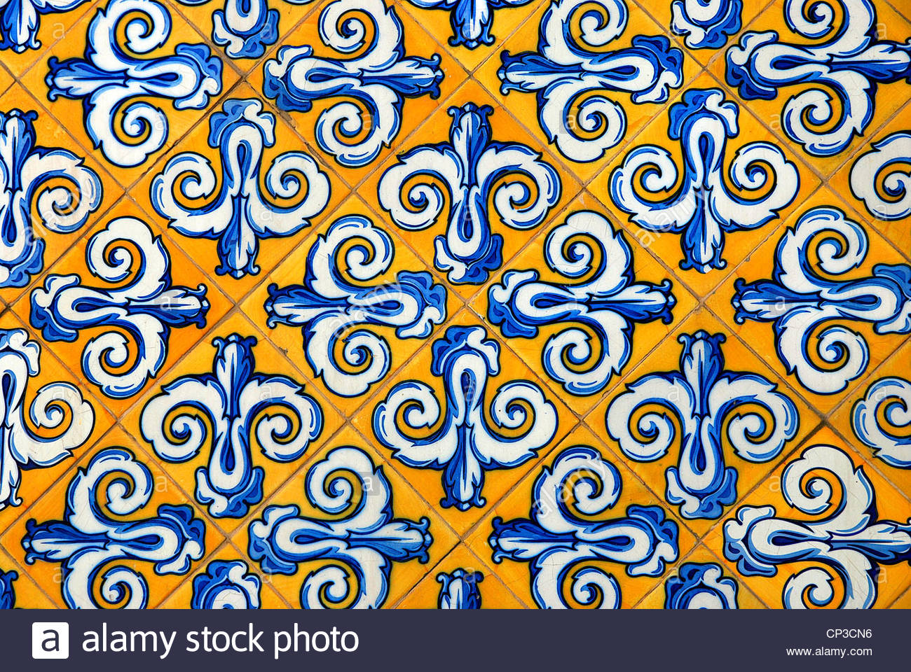Traditional spanish ceramic tiles in yellow and blue stock photo stock photo traditional spanish ceramic tiles in yellow and blue dailygadgetfo Gallery