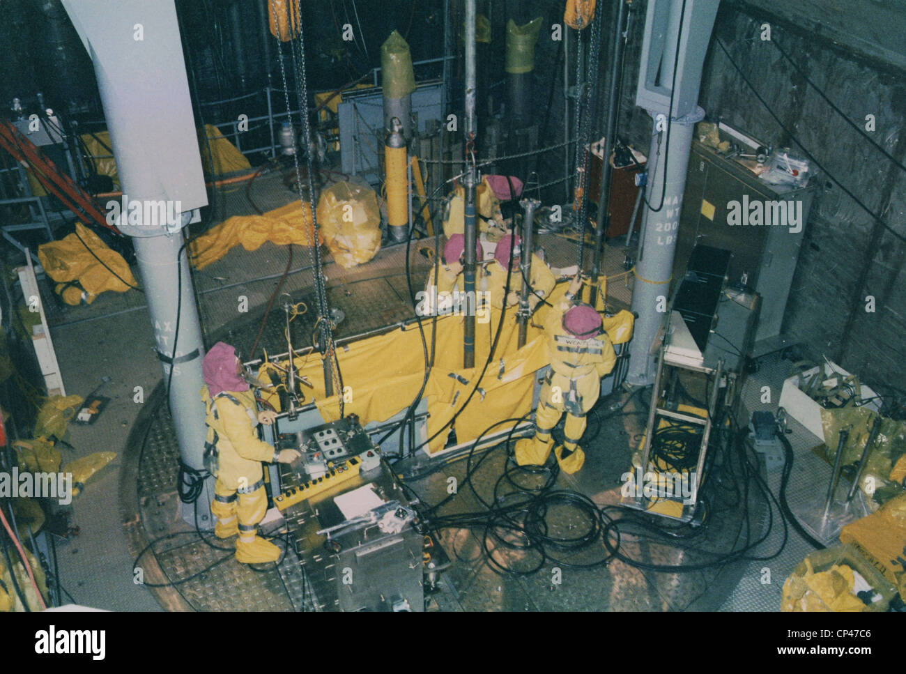 Nuclear engineers inside Unit 2 of the Three Mile Island ...