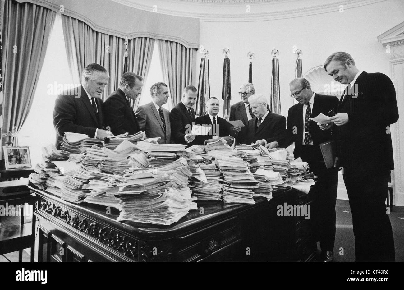 Nixon cabinet members reading telegrams in the Oval Office. On Nov ...