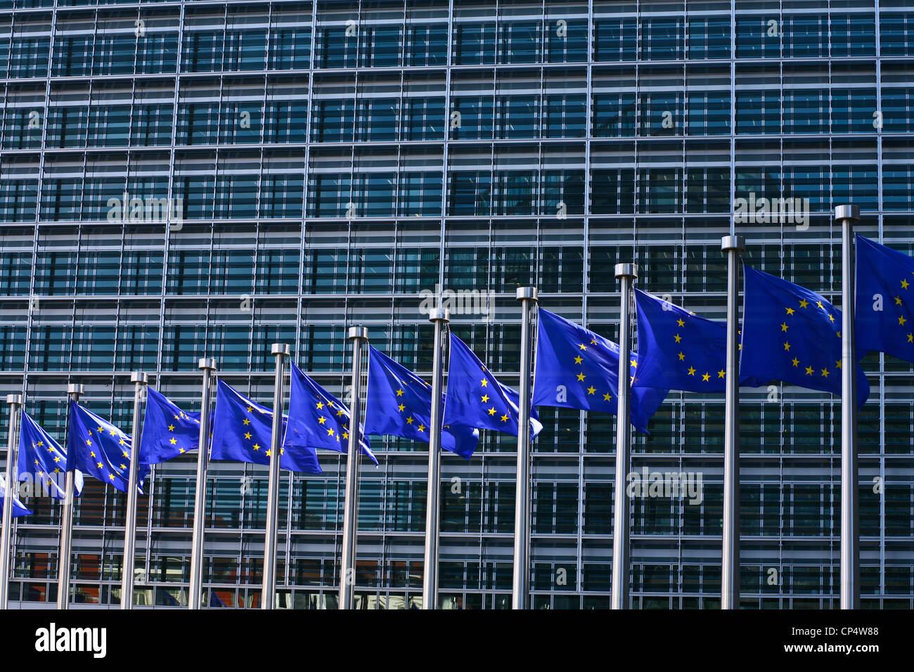 eu flags fronting the berlaymont an office building in brussels that houses the headquarters of the european commission building an office