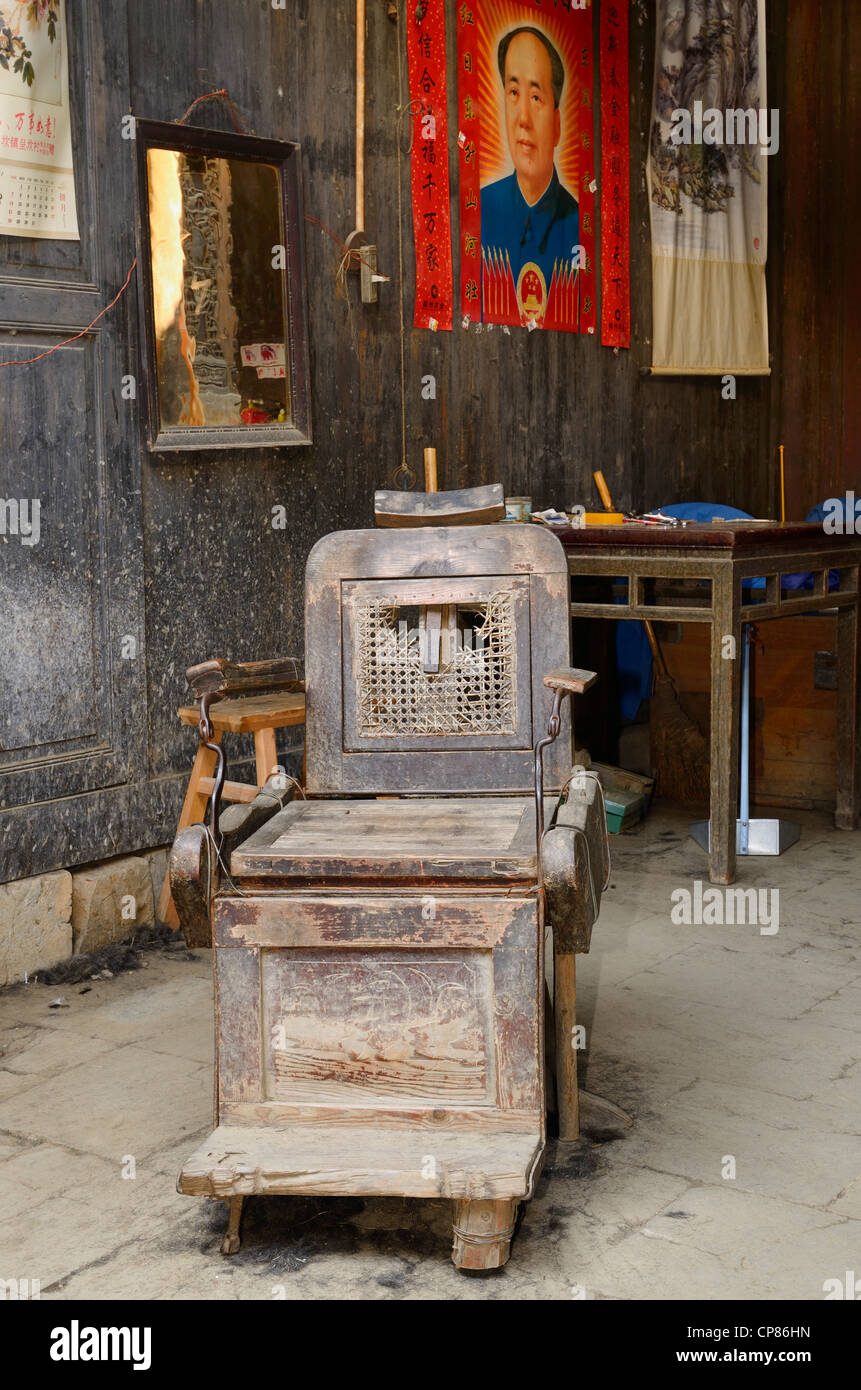 Old barber shop chairs - Old Barber Shop Chair With Mao Zedong Poster In Ancient Chengkan Village Huangshan Peoples Republic Of China