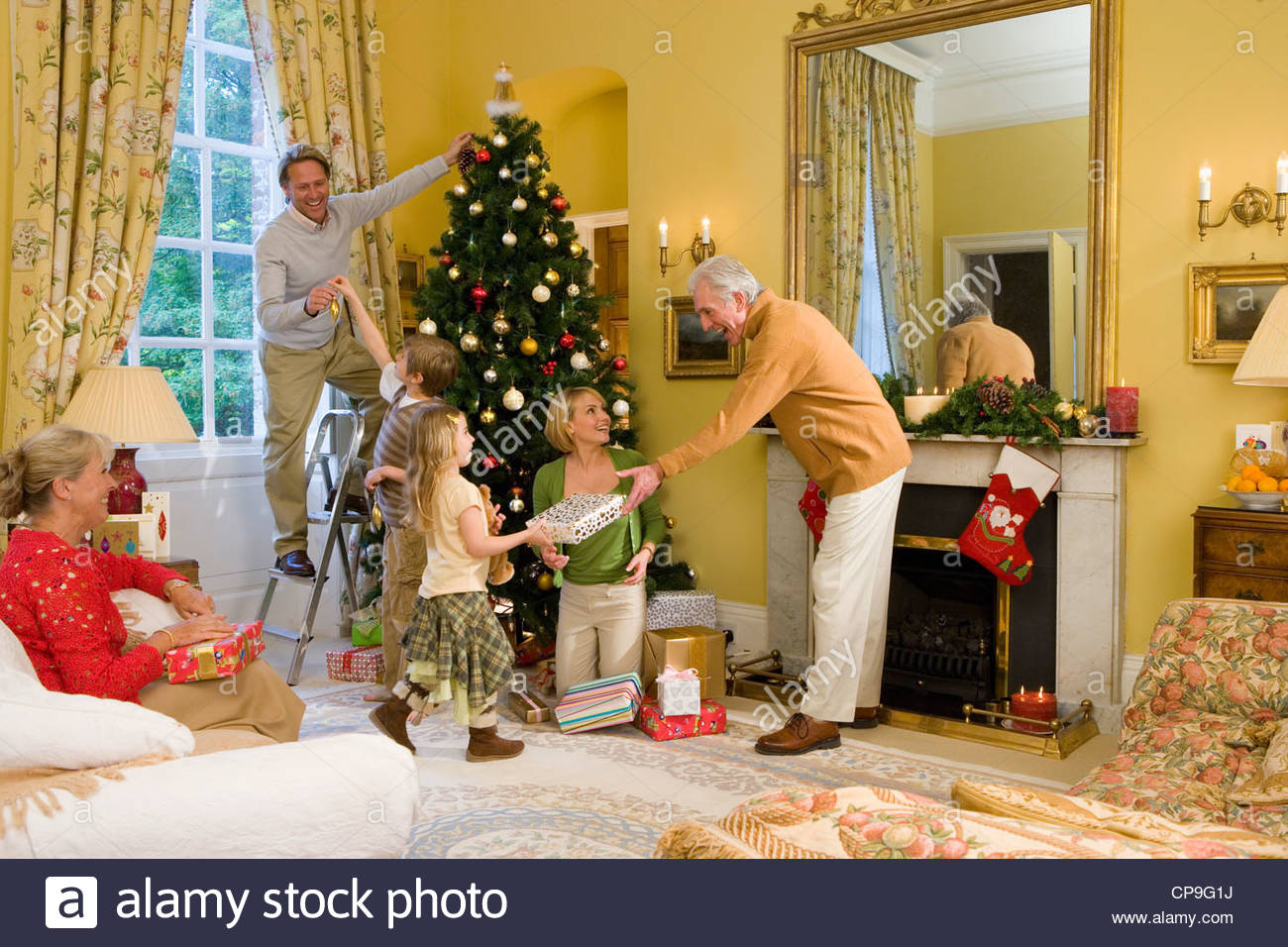 Attractive Family Around Christmas Tree Part - 10: Family Around Christmas Tree, Father Decorating Tree, Grandfather Giving  Gift To Girl (5-7)