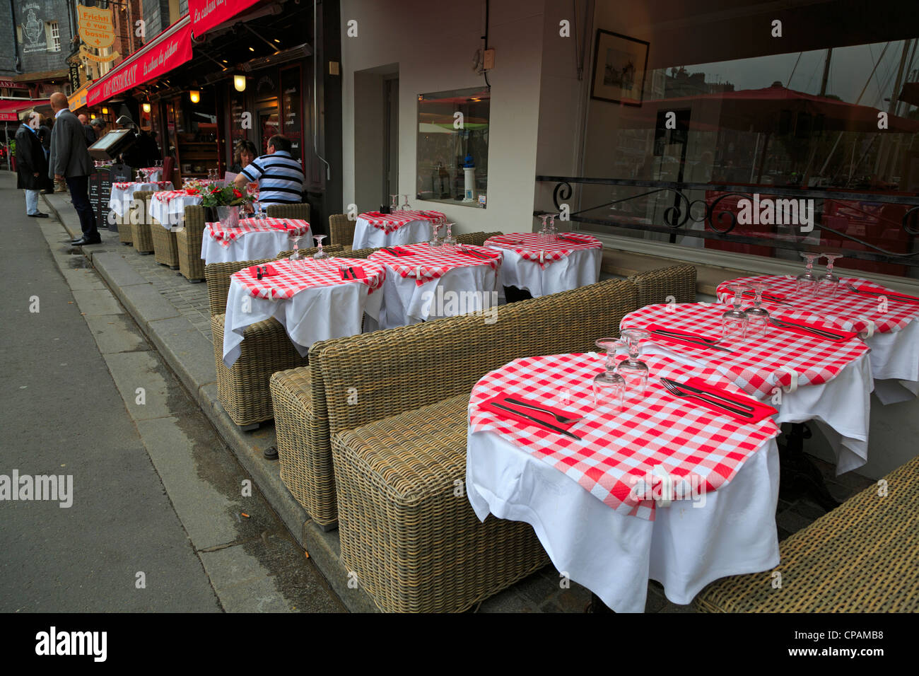 Lovely Cheerful Red And White Check Tablecloths Of A Bistro Alongside The Wharf.