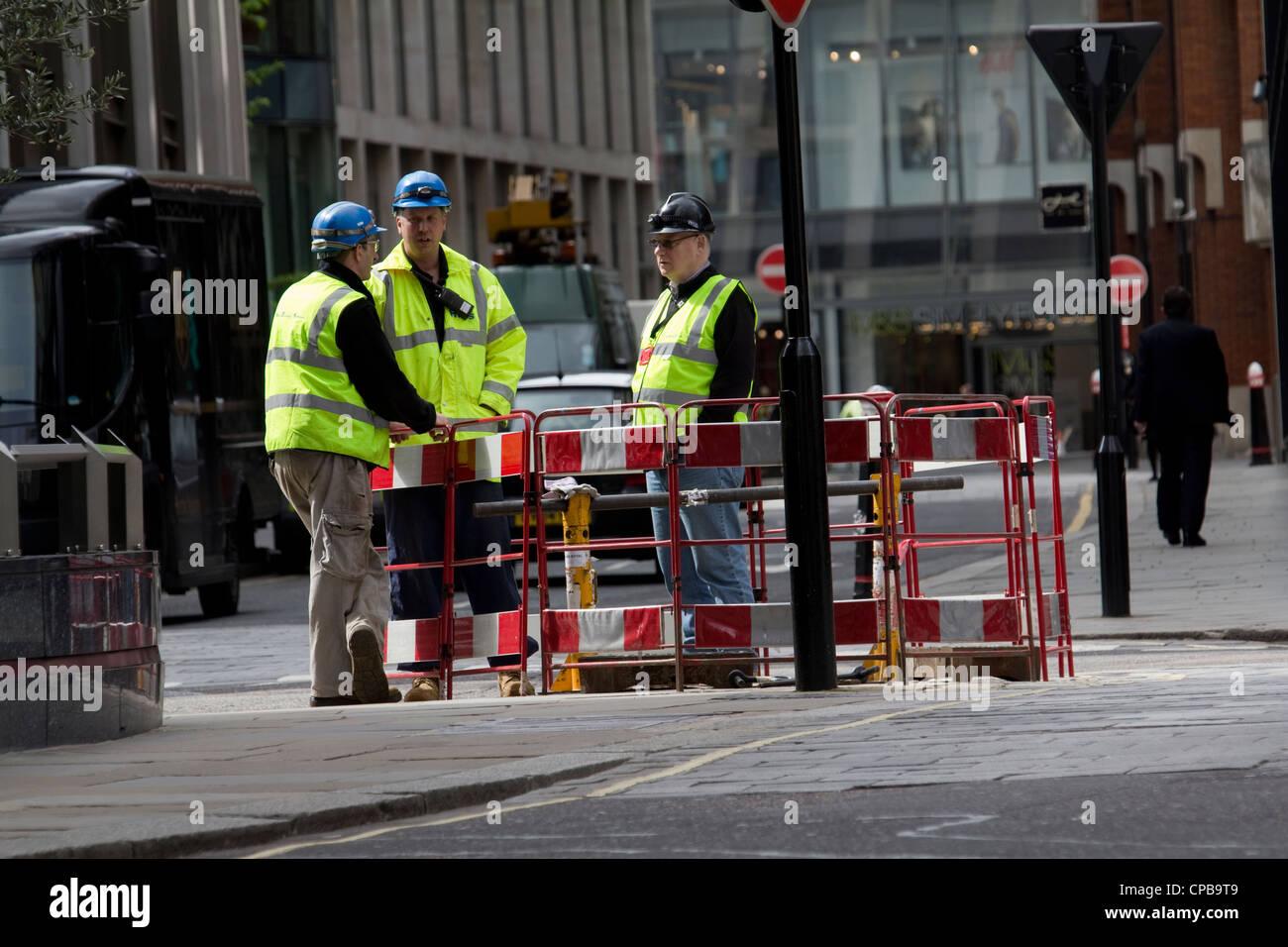 Roadworks, road works, workmen contractors standing around ...