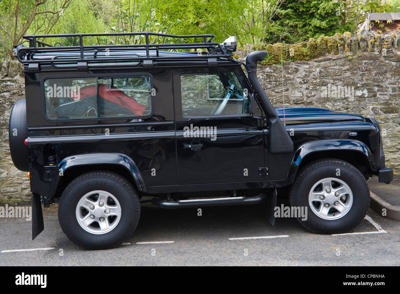 black land rover defender 90 2 4tdci 4x4 with safari snorkel and roof stock photo royalty free. Black Bedroom Furniture Sets. Home Design Ideas