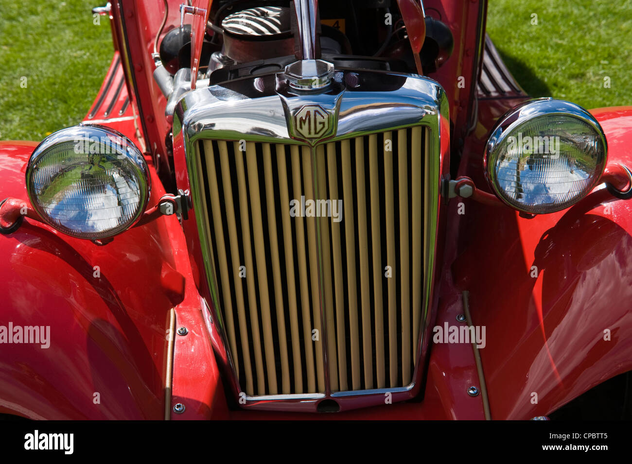 Vintage classic red MG convertible sports car on display at the ...