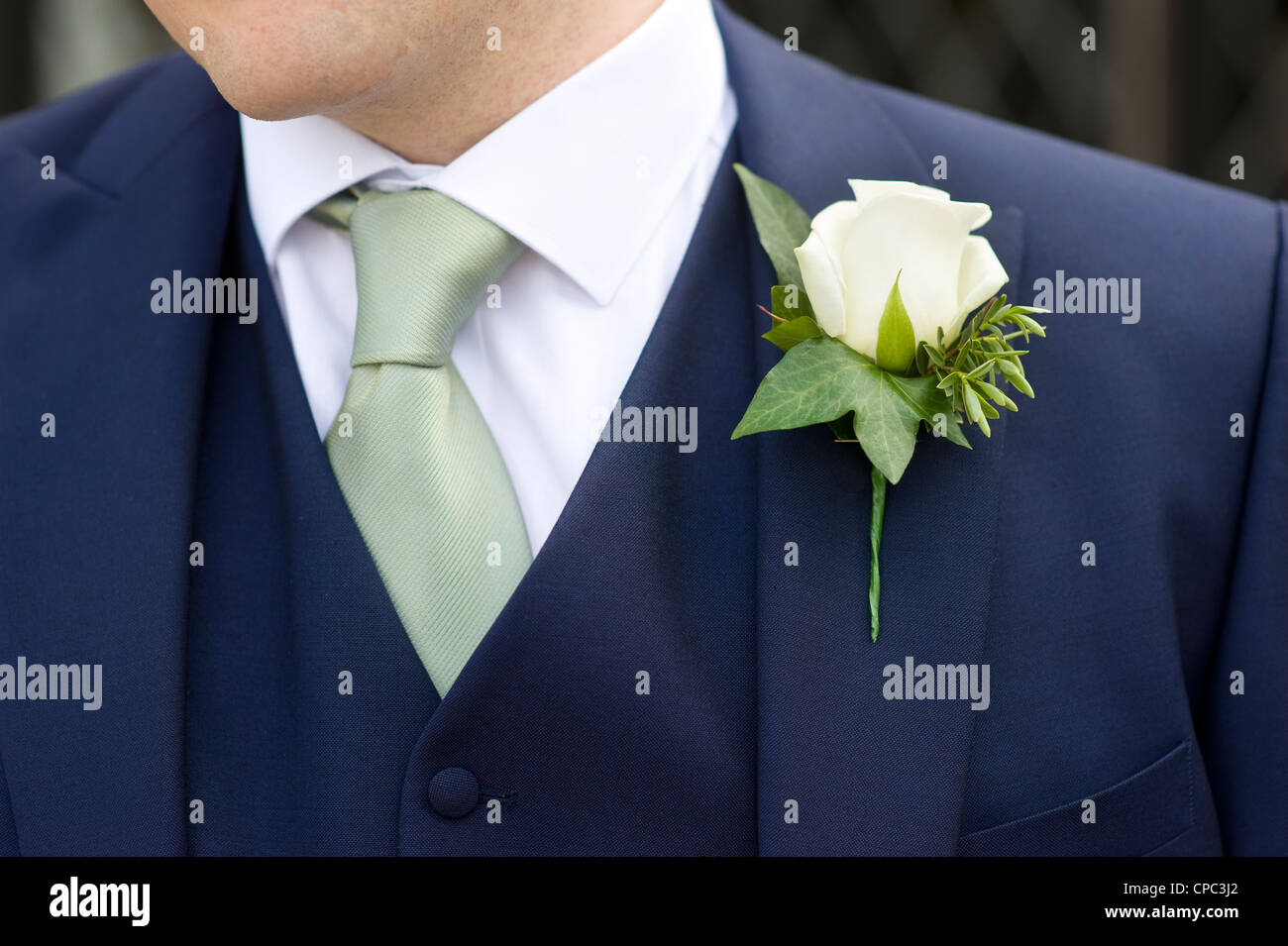How To Make Wedding Buttonholes: Man At A Wedding Wearing A Floral Buttonhole Stock Photo
