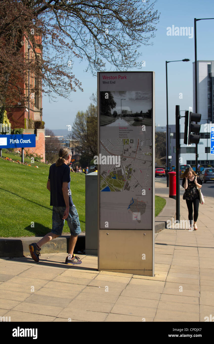 Large information sign with map and directions in middle of footpath