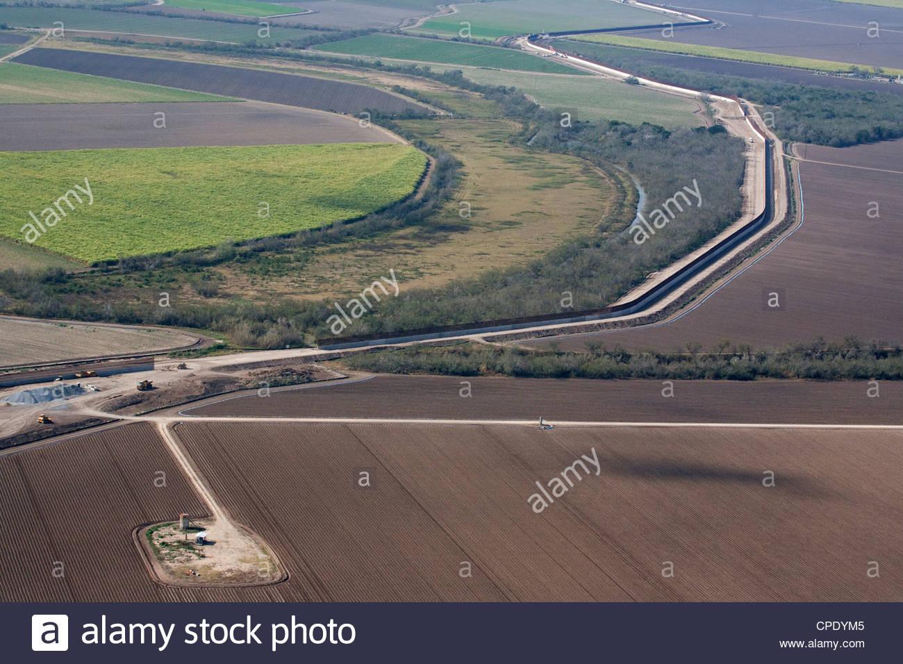 Aerial of border wall fence hidalgo county lower rio grande valley texas near mexico rio grande