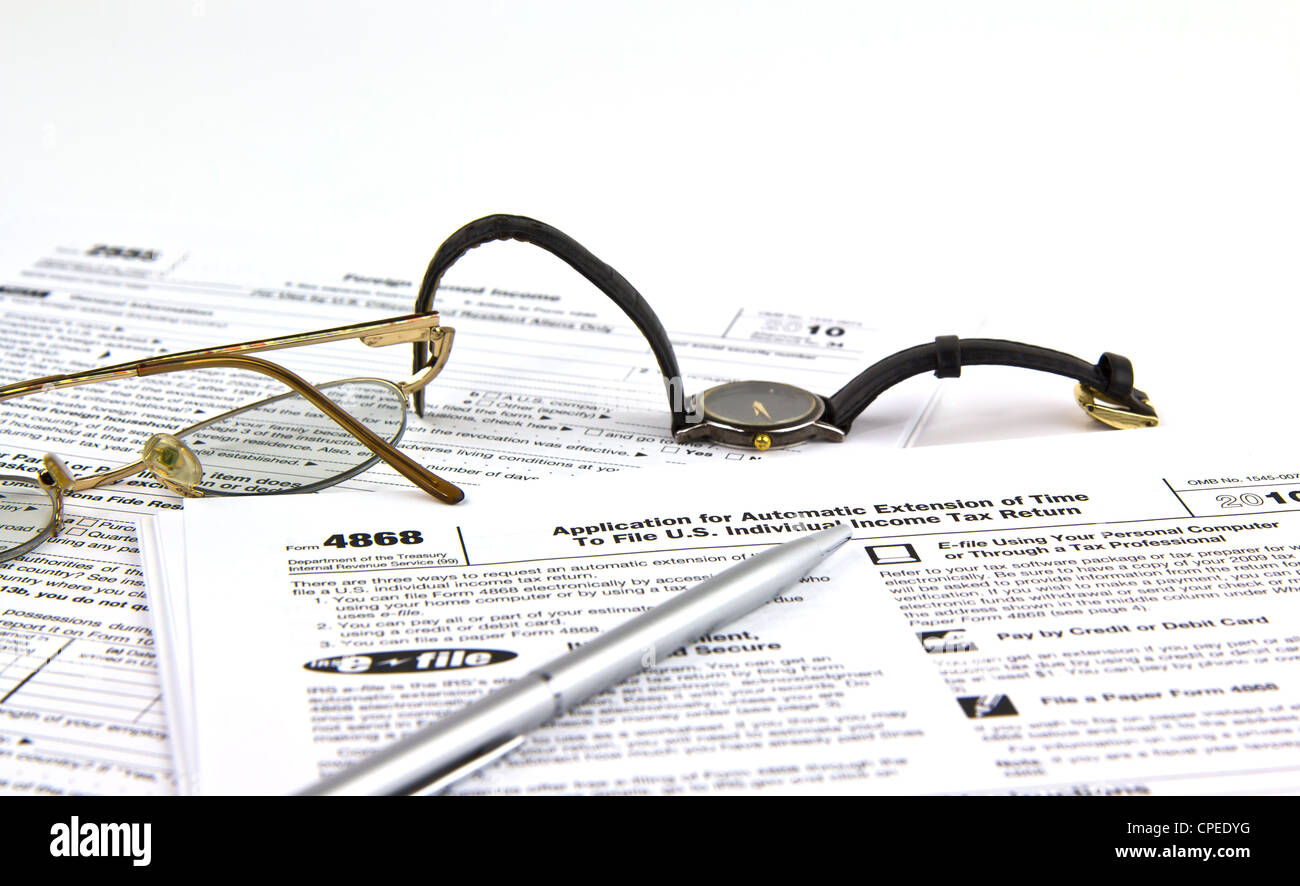 Irs tax extension form 4868 with pen watch and glass stock irs tax extension form 4868 with pen watch and glass falaconquin