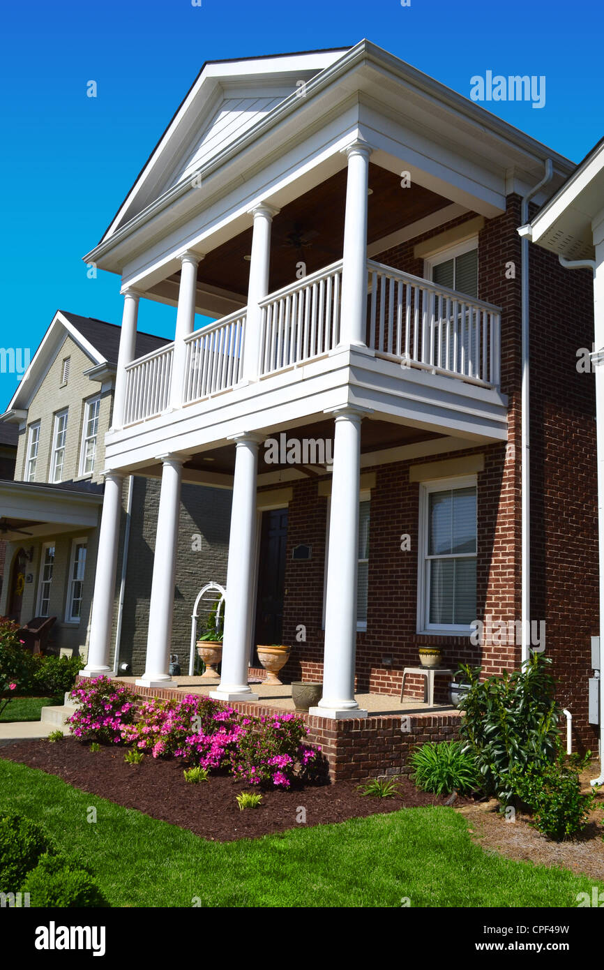 Covered front porch craftsman style home royalty free stock image - Brick Craftsman House With White Columns And Front Porch And Second Level Patio
