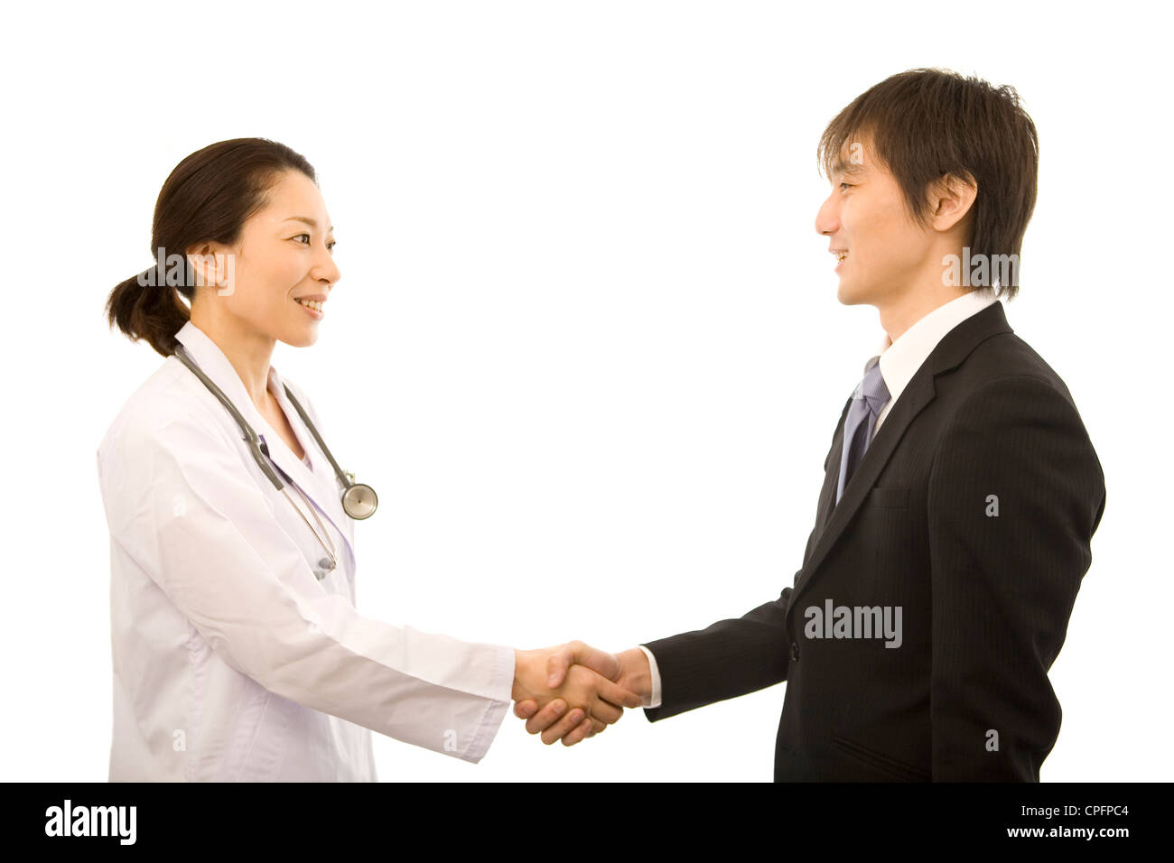 female doctor and pharmaceutical s representative shaking female doctor and pharmaceutical s representative shaking hands