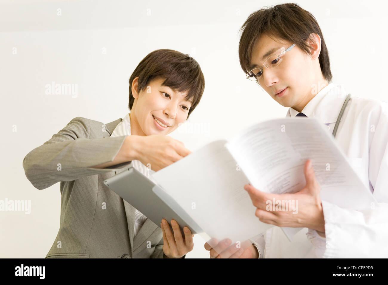 pharmaceutical s representative showing file to doctor stock pharmaceutical s representative showing file to doctor