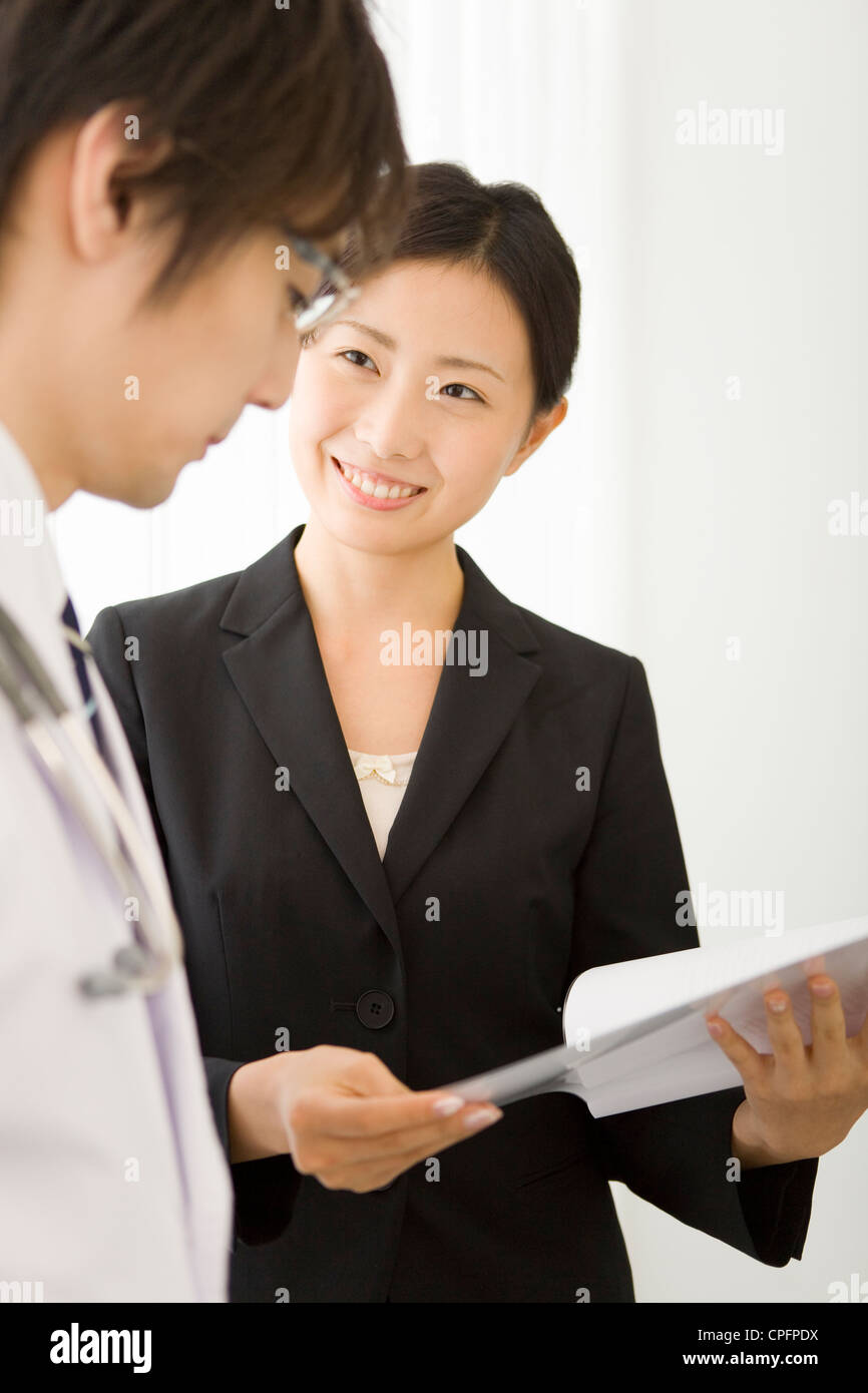 pharmaceutical s representative showing file to doctor stock pharmaceutical s representative showing file to doctor