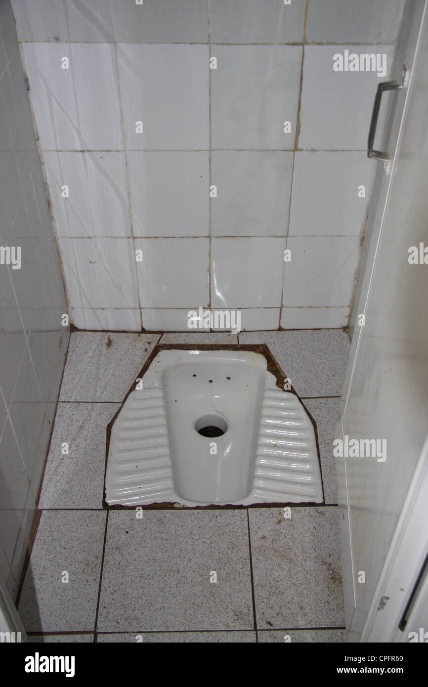 Greek style toilet in natpaktos public washroom stock for Washroom style