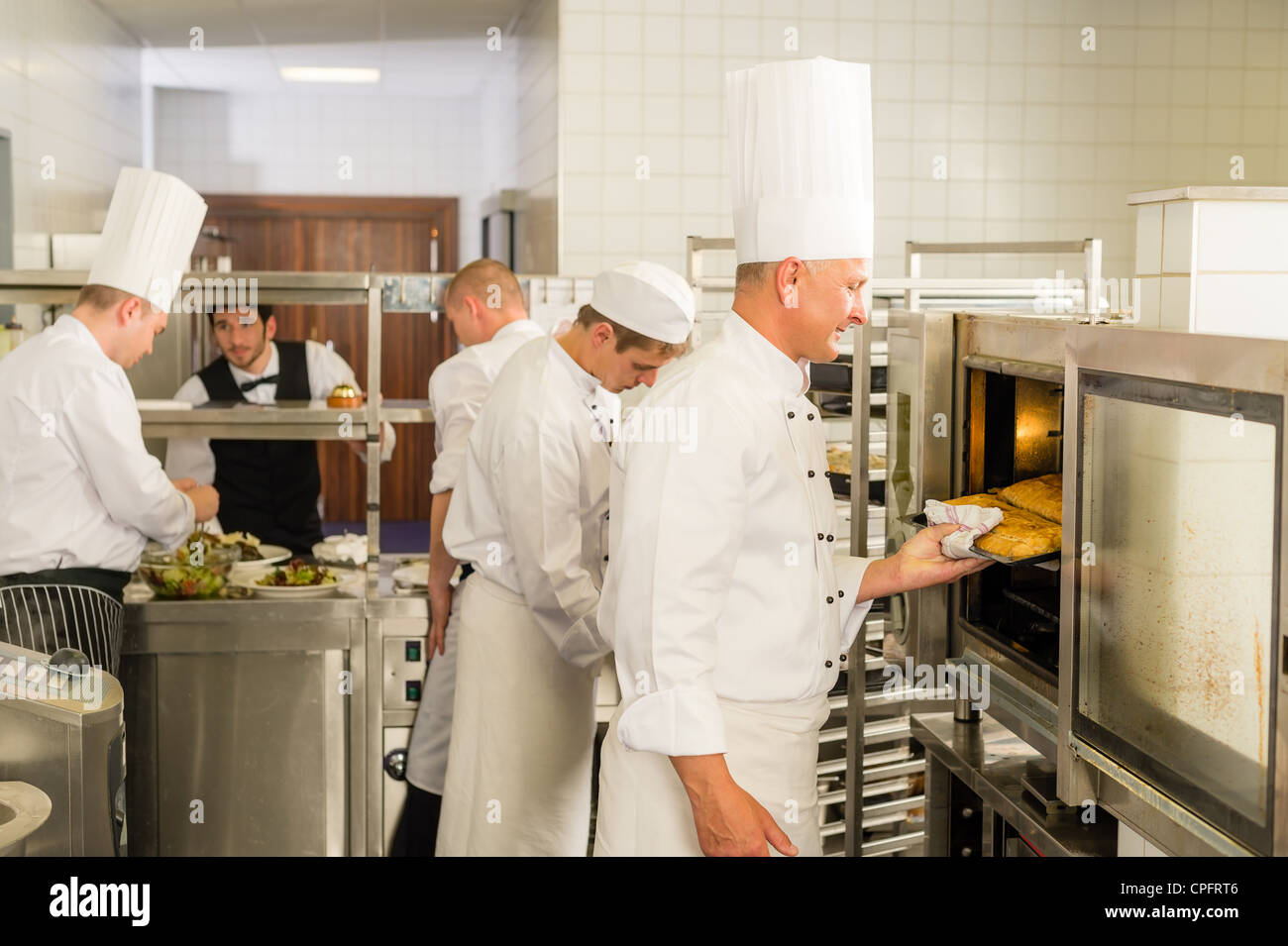 Exterior: Group Of Cooks In Professional Kitchen Prepare Meals