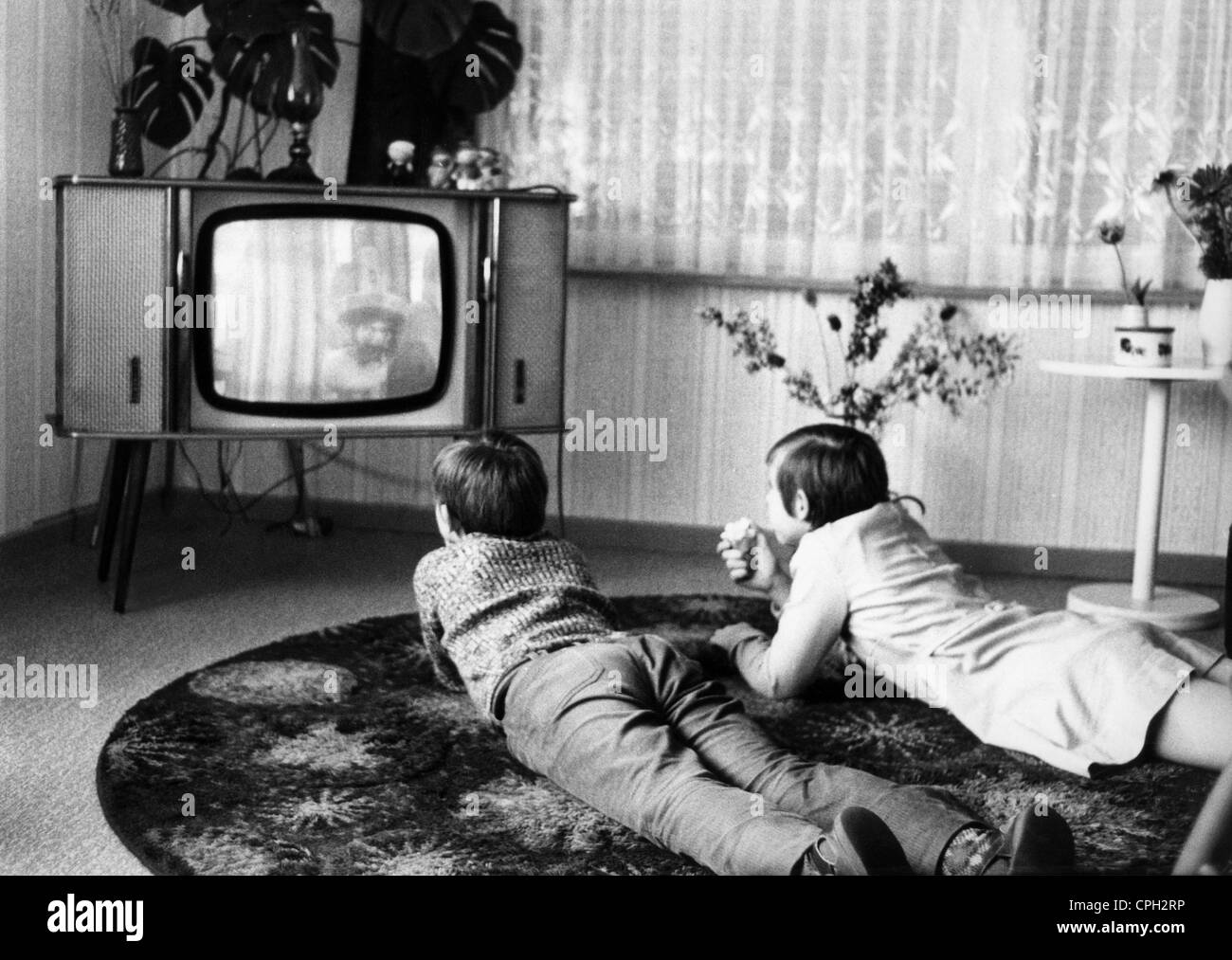 black kids watching tv. stock photo - broadcast, television, children watching tv, april 1972, 20th century, historic, historical, 1970s, 70s, watch televis black kids tv s