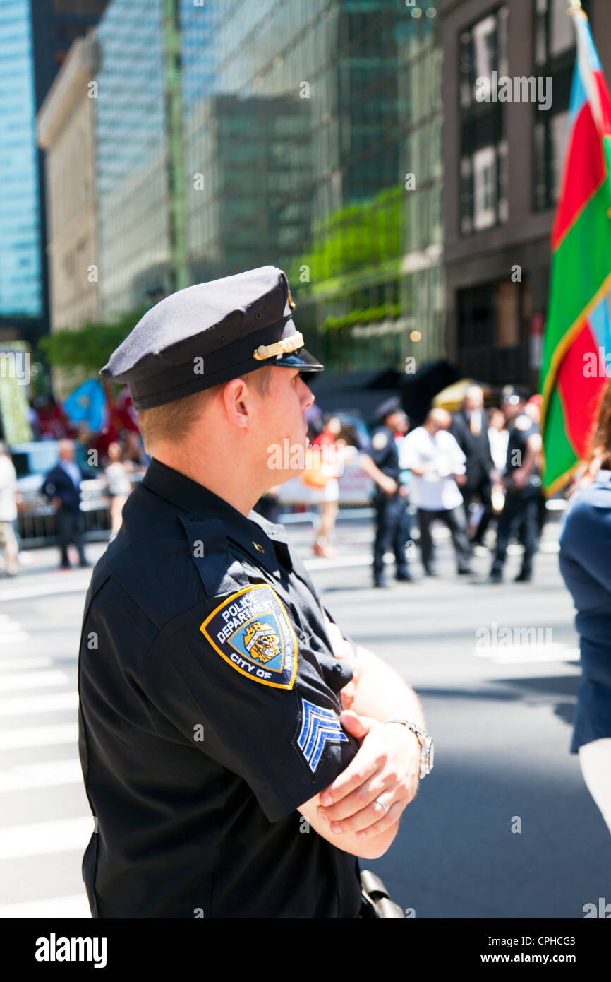 close detail of nypd police officer and badge on shoulder of