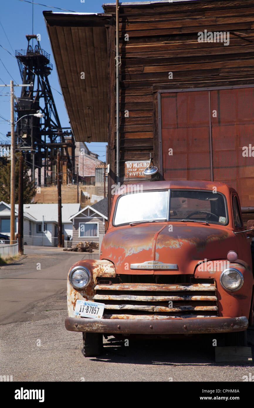 Old Chevy truck, mine headframe, Butte, Montana, USA Stock Photo ...