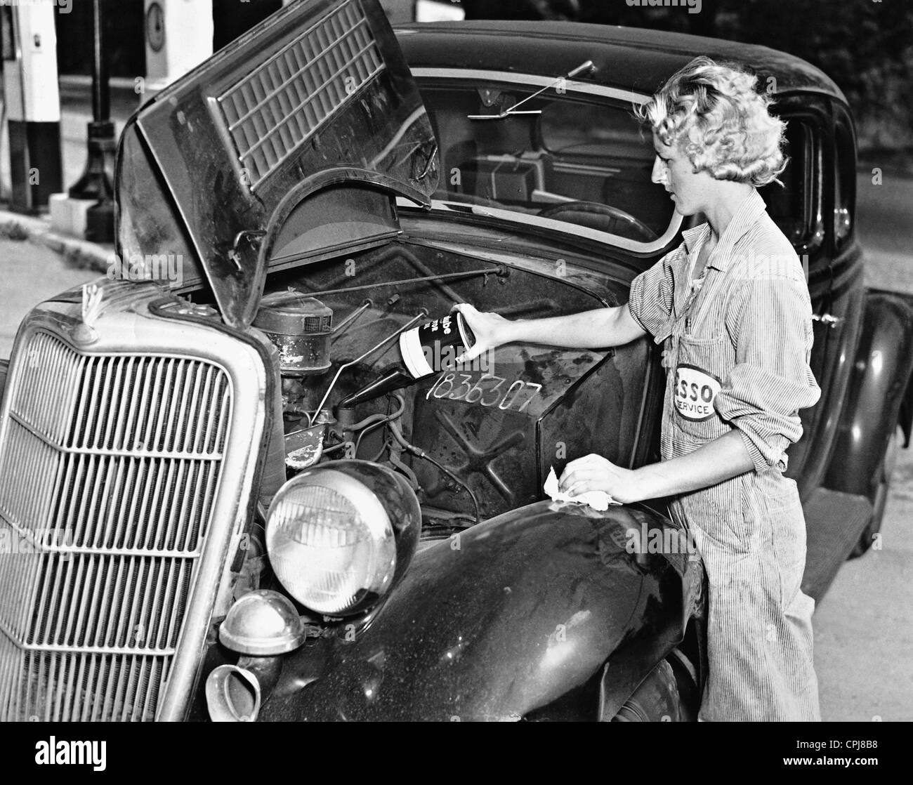 A female car mechanic fills oil, 1937 Stock Photo, Royalty Free ...
