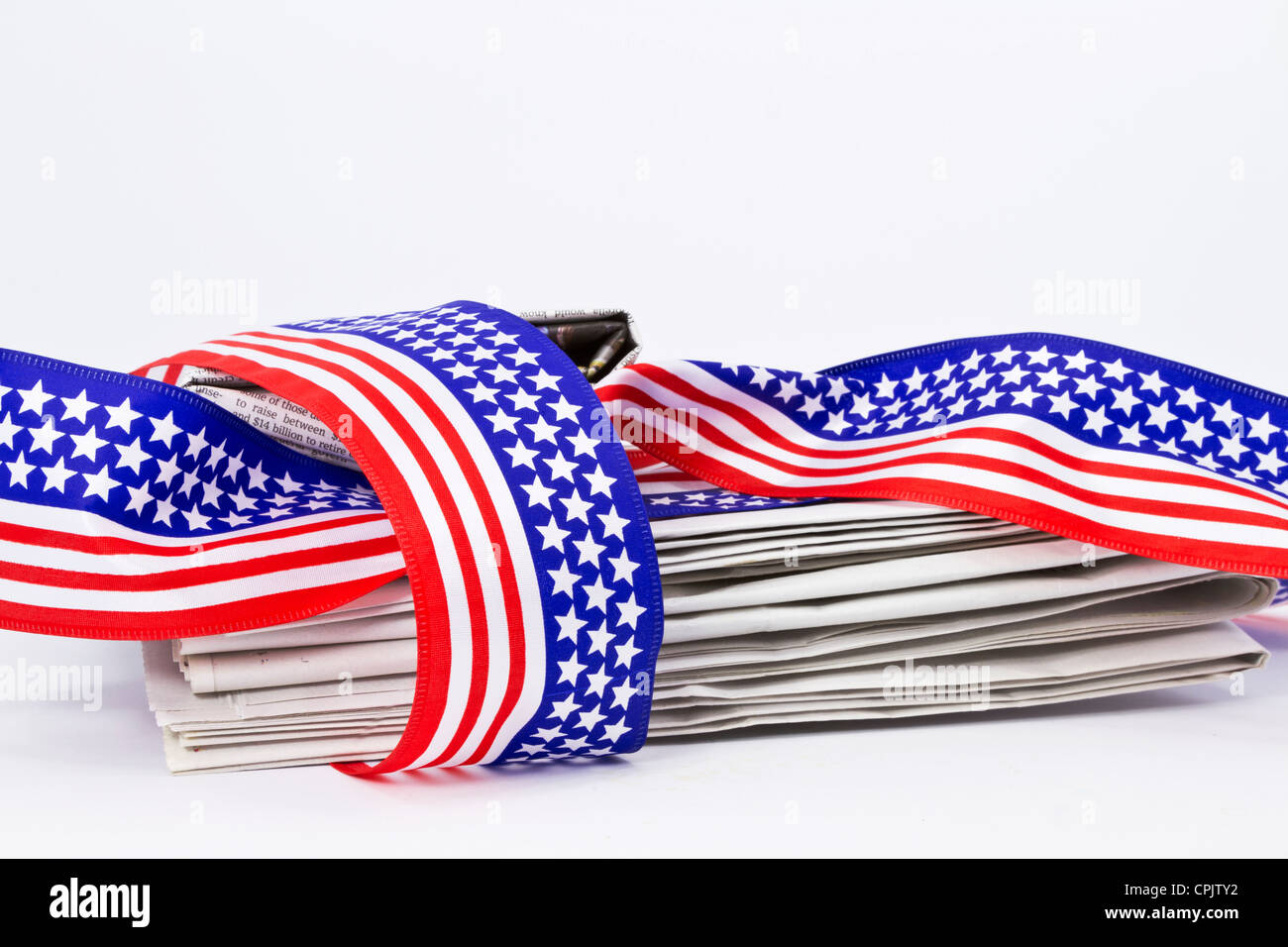 Stack Of Newspaper Loosely Wrapped In Usa Flag Colors And Symbols Of