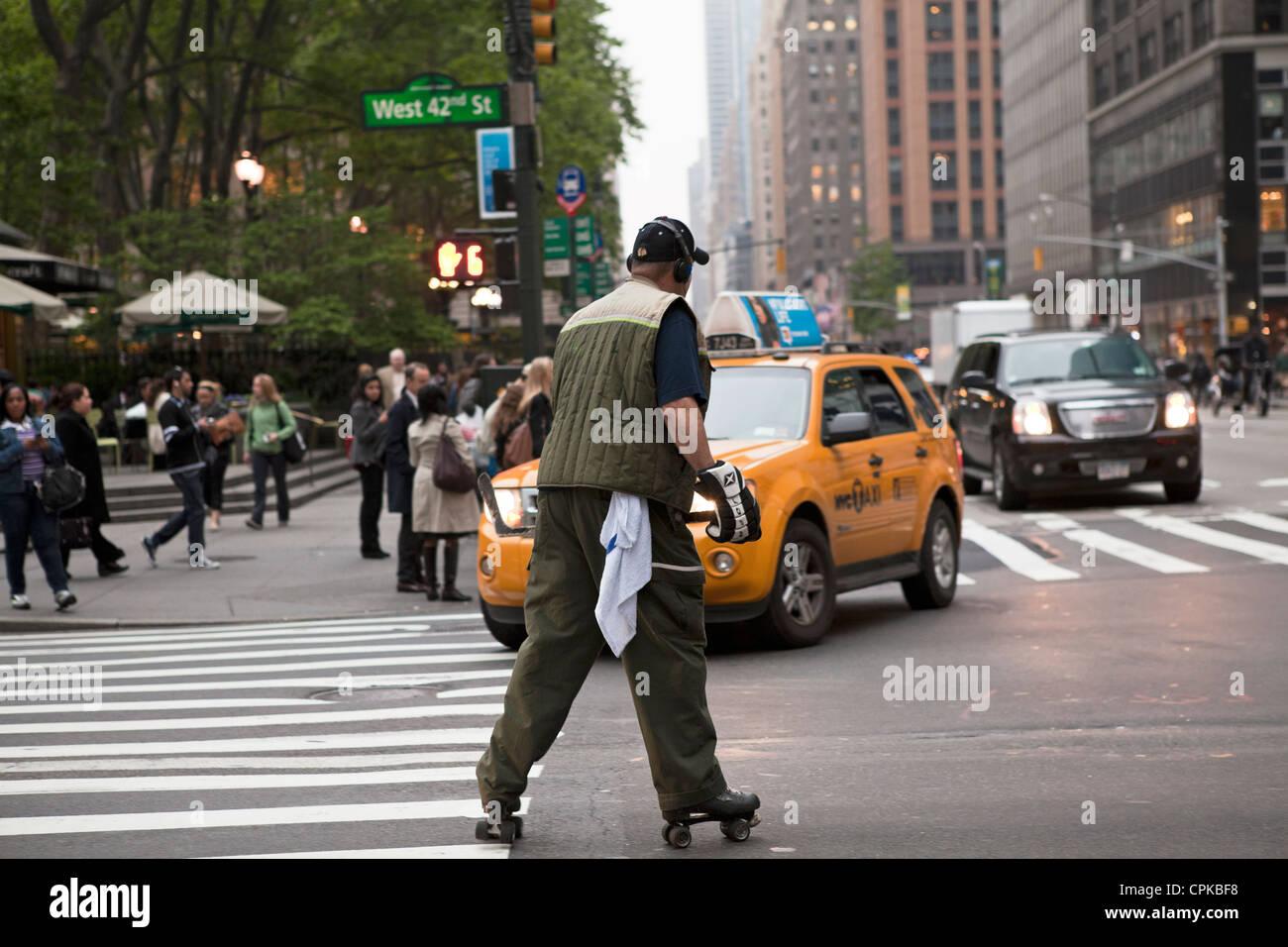 Roller skates york - A Man Wearing Hockey Gear Roller Skates In The Street In New York City