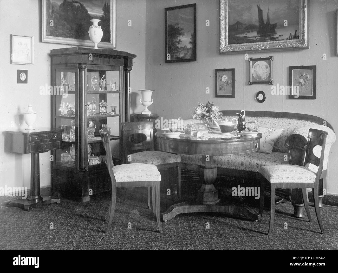 Upper middle class living room - Stock Photo Upper Middle Class Living Room Around 1900