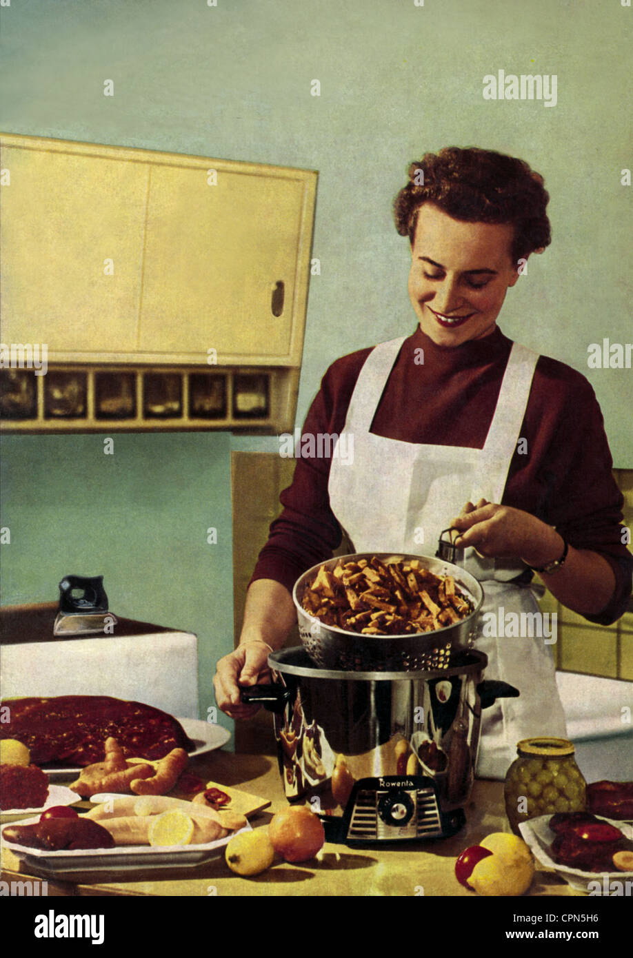 White apron food - Stock Photo Household Kitchen Housewife Is Cooking Advertising For Rowenta Chip Pan Germany 1958 Kitchens Woman White Apron Cooky