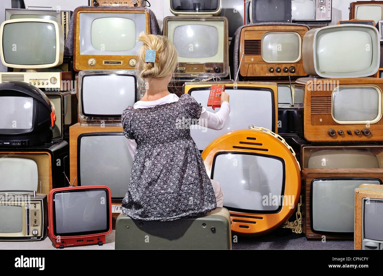 Broadcast television girl with television sets of the 50s years broadcast television girl with television sets of the 50s years up to 70s years symbol image germany children child kids buycottarizona