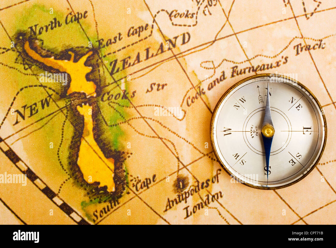 New zealand old map stock photo royalty free image 50290489 alamy antique compass and old map of captain cooks journeys showing new zealand stock gumiabroncs Gallery