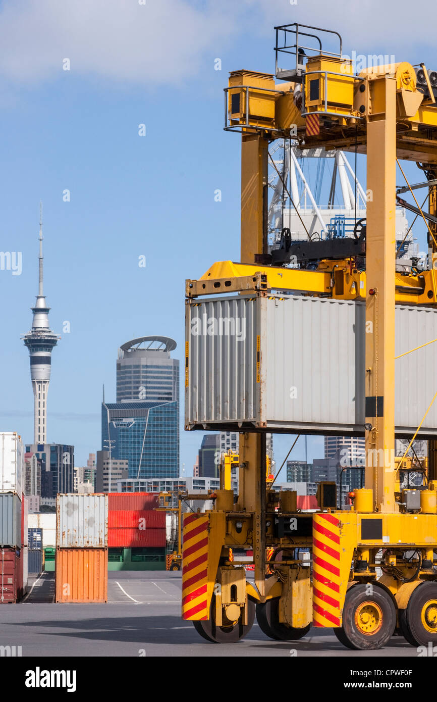 A straddle carrier moving a shipping container on the wharf in the port of auckland