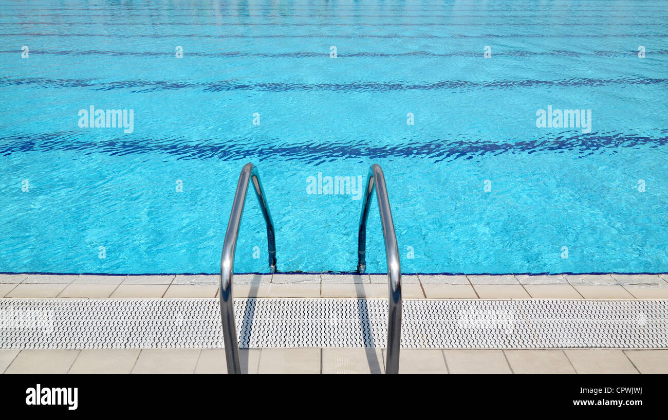 steel ladder at open air olympic size swimming pool - Olympic Size Swimming Pool
